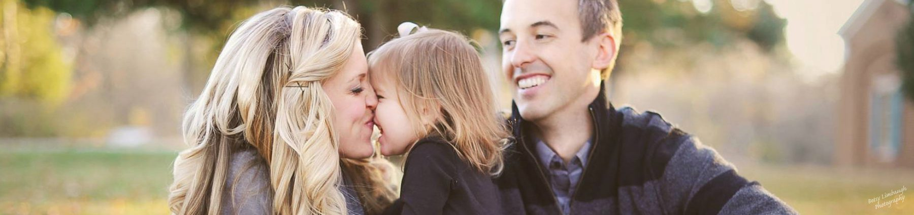 Mom and dad with daughter who has Rett Syndrome