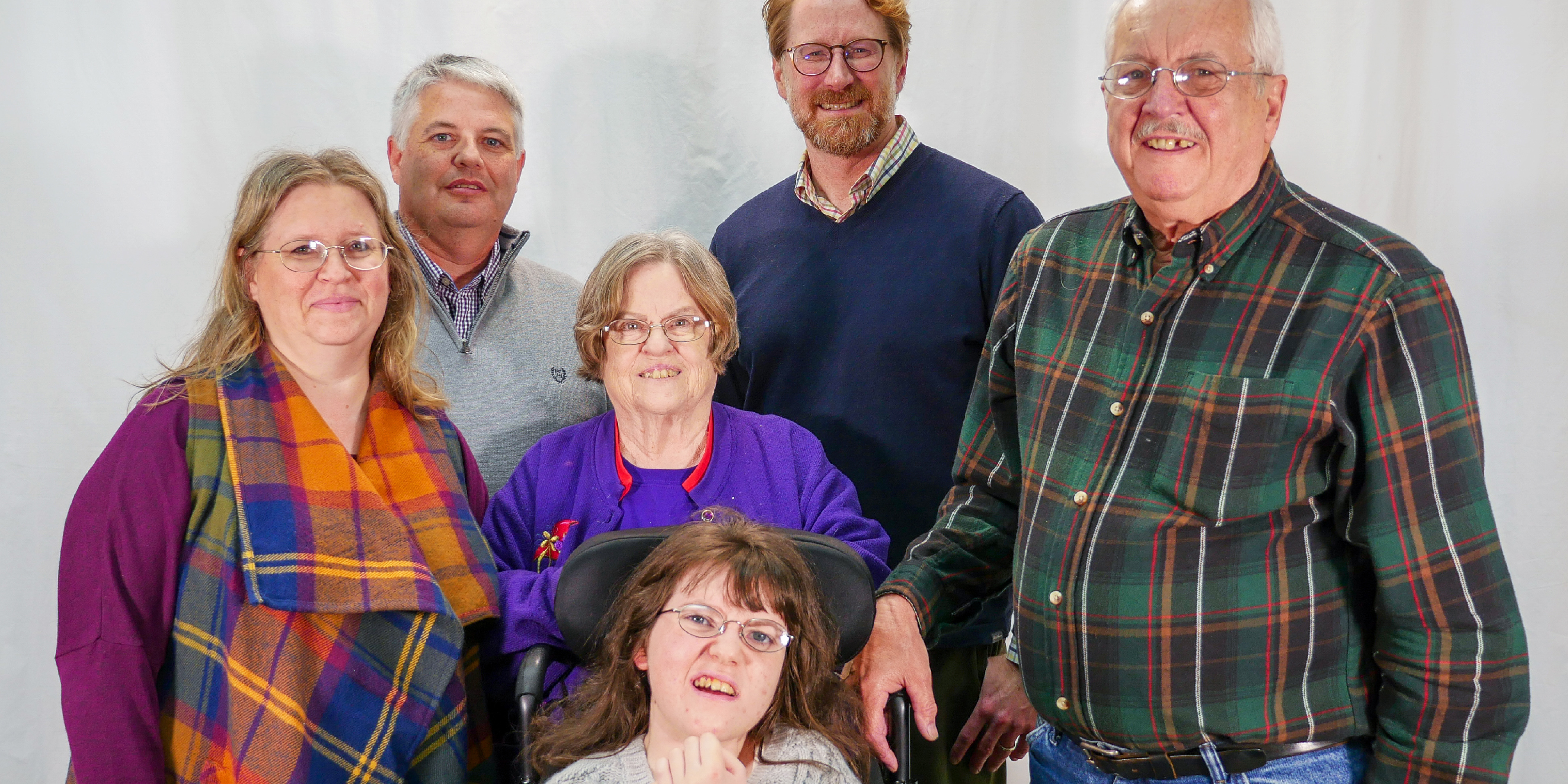 Parents and other family members with young woman who has Rett syndrome